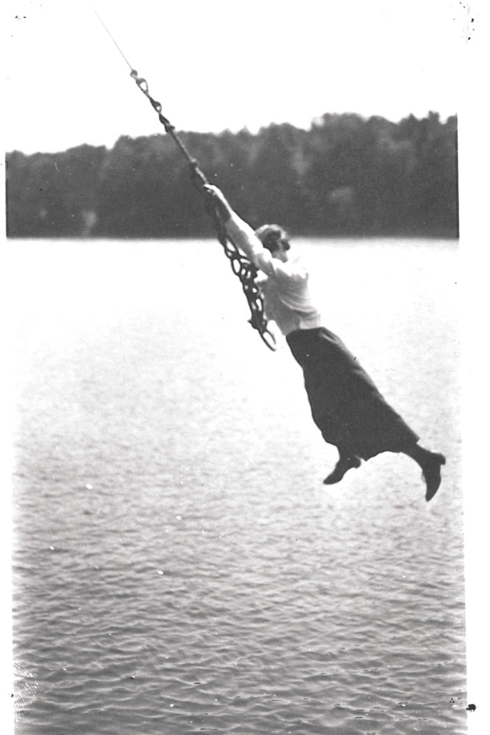 Woman on rope swing at Red Wing company picnic, Adams Pasture, Trenton WI, 1919